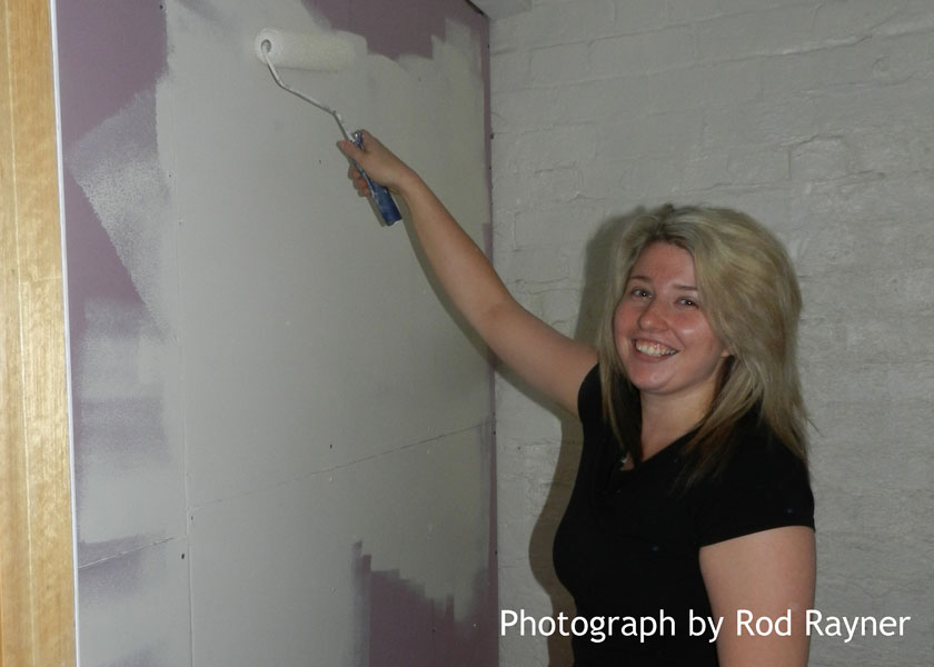 Dayna painting the extractor fan room