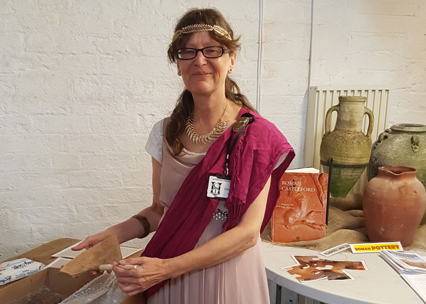Jeanette Bannister with a display of Roman pottery